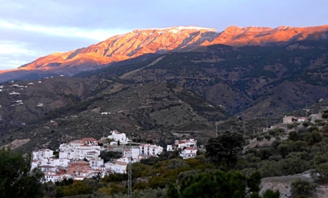 The first of the morning sun hitting mount Maroma above the village of Canillas de Albaida as seen from our terrace.
