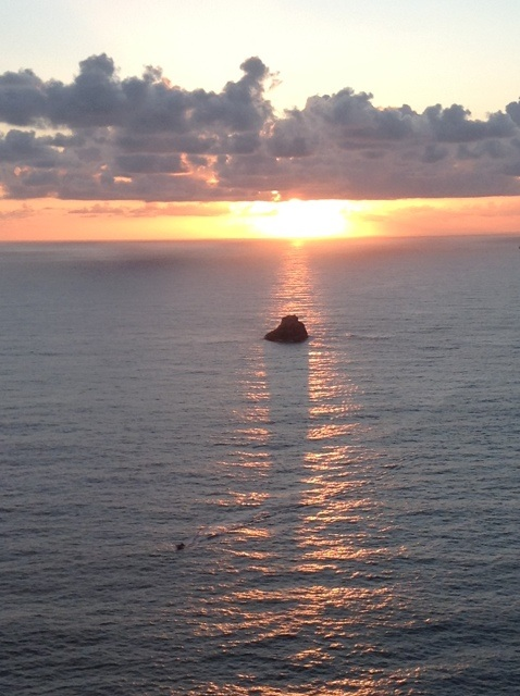 the sun sinking into the ocean at the 'end of the world' - Finisterre
