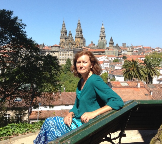 sitting in the park above Santiago de Compostela with the spires of the cathedral in the background