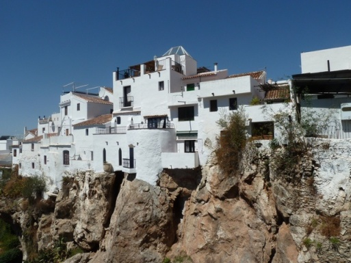 Characterful townhouses perch high on an outcrop of rock, viewed from the mirador