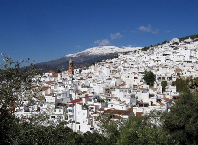 The white mountain village of Cómpeta with a snow-capped mount Maroma as a backdrop.