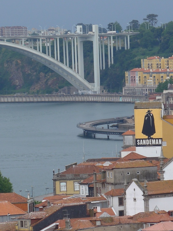 Standing on the Dom Luis bridge looking towards the AutoEstrada-do-Norte bridge with the familiar Sandeman logo in the foreground
